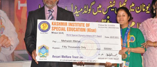 Basharat Shaheen presenting a cheque of 50,000 RS to Mehwish Iftakhar on behalf on  Ansari Welfare Trust UK